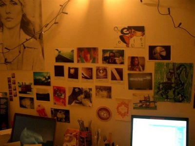Collage of photos hanging on a wall.