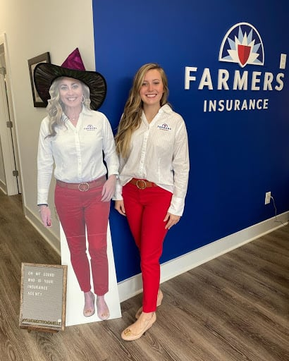 Danielle Stack Farmers Insurance cardboard standee with woman.