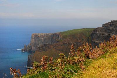 Edge of a cliff overlooking ocean.