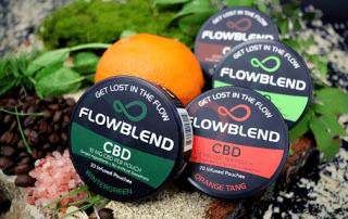 Several cans of FlowBlend's CBD product.