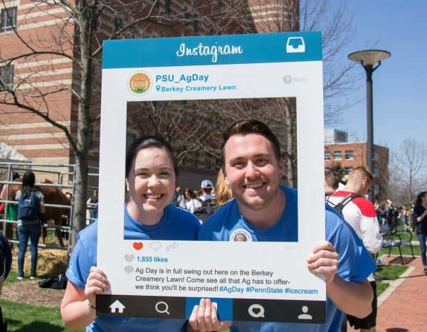 Couple with Instagram selfie frame.