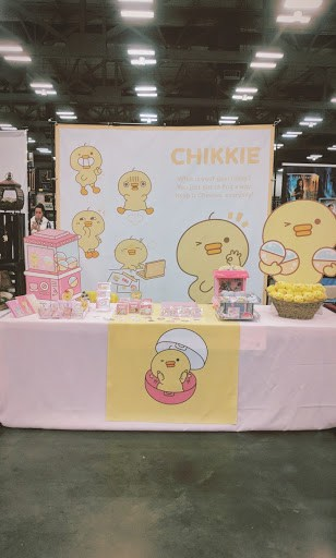 KawaiiChikkie indoor table setup with cardboard cutout.