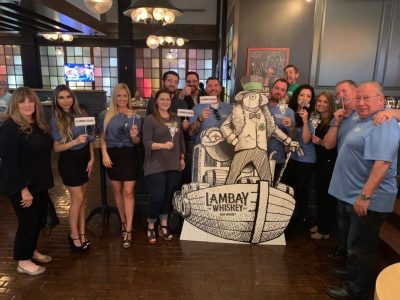 Lambay Whiskey cardboard cutout with team.