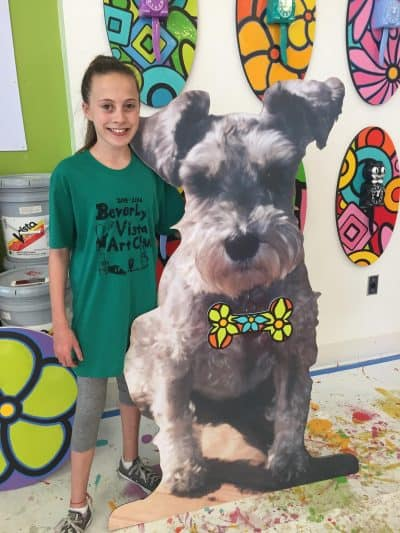 Large Maddie dog cutout with girl.