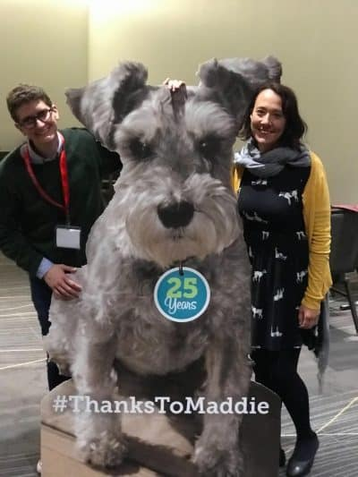 Large Maddie dog cutout with Rory Adams and Kristen Auerbach.