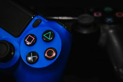 Close-up image of buttons on a Playstation controller.