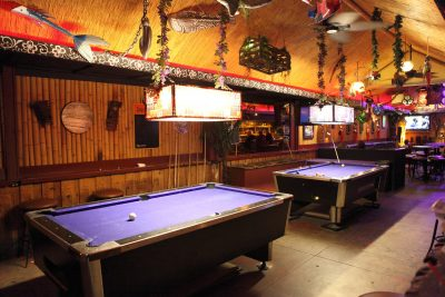 Pool tables in a sports bar.