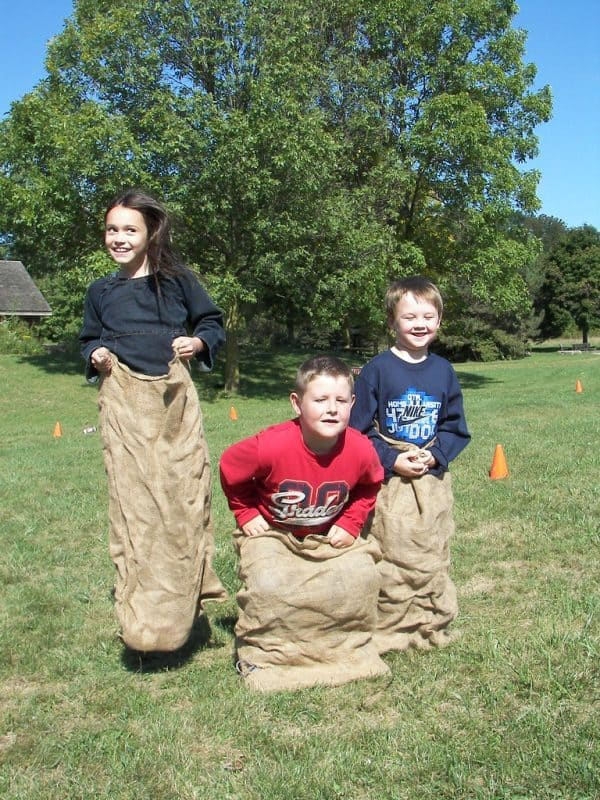 Three children potato sack race.