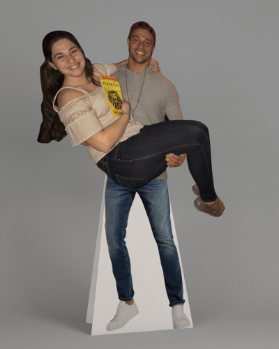 Man and woman cardboard cutouts together.