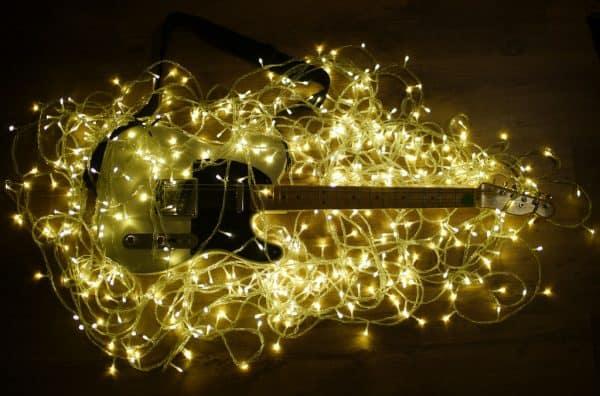 Fairy lights for TikTok around a guitar.