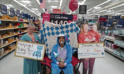 WalMart aisle display of patient ambassador cutout and donations advocates.